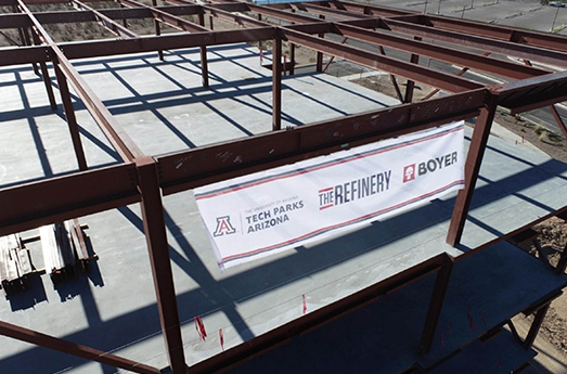 Photo of Final Steel Beam in Place on The Refinery Building